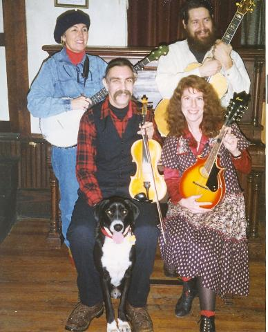 The Mustel House Muscrats at Square dance in Norton, OH<br>  Top<br>      Sid Cayhoe, Jon Mosey<br> Sitting <br>     Chris Wig, Chris hazen<br>  and Chris's dog Pete